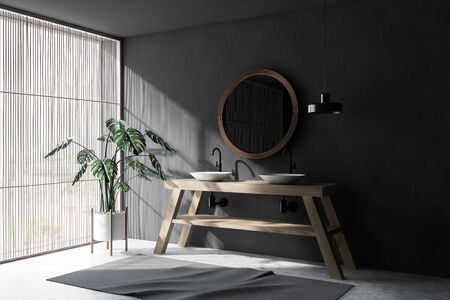 Corner of minimalistic bathroom with gray walls, concrete floor, light wooden blinds, double sink standing on wooden countertop and round mirror. 3d rendering