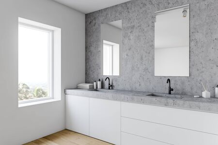 Corner of stylish bathroom with white and stone walls, wooden floor, double sink standing on white countertop and two vertical mirrors. 3d rendering