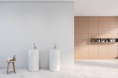 Interior of spacious bathroom with white and beige tile walls, concrete floor, round double sink, shelves with shampoo. Concept of spa. 3d rendering