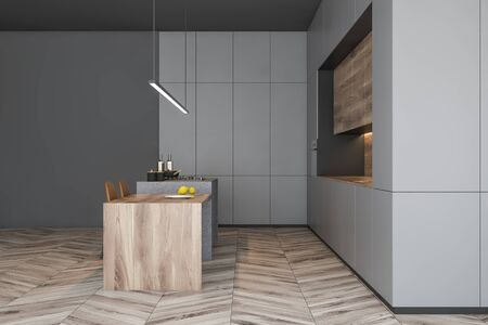 Side view of modern kitchen with gray walls, wooden floor, grey countertops, wooden cupboards and wooden bar with stools. 3d rendering