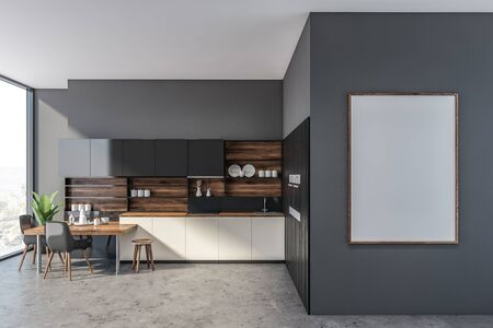 Interior of modern kitchen with concrete walls and floor, white countertops, black cupboards, two built in ovens and stylish table with black chairs. Vertical mock up poster. 3d rendering 写真素材