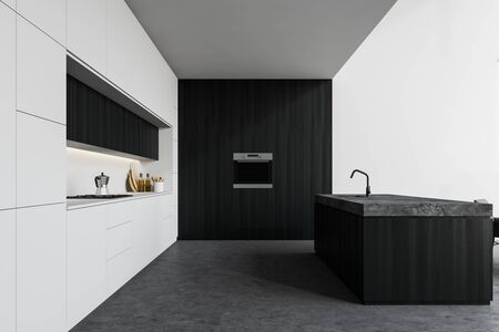Interior of stylish kitchen with white and dark wooden walls, concrete floor, white countertops, dark wooden island with built in sink and oven. 3d rendering
