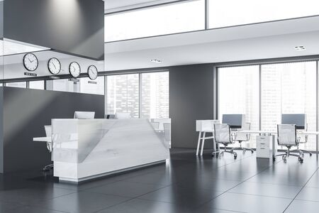 Corner of stylish open space office with gray walls, tiled floor, rows of computer tables and glass and light wooden reception table with clocks above it. 3d rendering