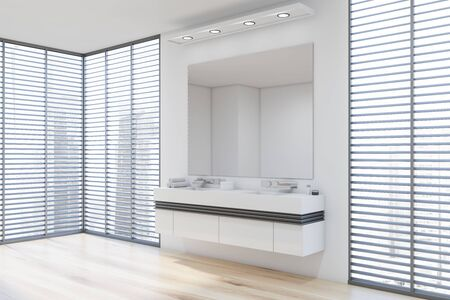 Corner of stylish bathroom with white walls, wooden floor, double sink standing on white countertop with large mirror above it and windows with blinds. 3d rendering Stok Fotoğraf