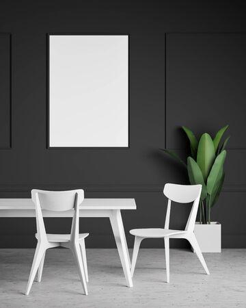 Cadre d'affiche vertical suspendu dans une salle à manger moderne avec des murs gris foncé, un sol en béton, une table à manger blanche avec des chaises et une plante en pot. rendu 3D