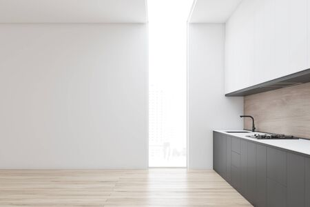 Side view of minimalistic kitchen with white and wooden walls, wooden floor, gray countertops with built in sink and cooker and white cupboards. 3d rendering