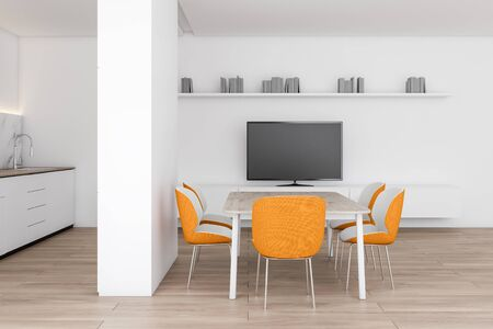 Interior of modern dining room with white walls, wooden floor, wooden table with orange chairs, TV on white cabinet and kitchen to the left. 3d rendering Stockfoto - 129407193
