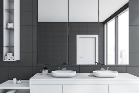 Close up of stylish bathroom with gray tile walls, double sink standing on white countertop and three vertical mirrors above it. 3d rendering Stock fotó