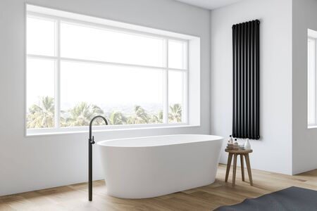 Corner of minimalistic bathroom with white walls, wooden floor, large window with tropical view and comfortable white bathtub. 3d rendering Stock Photo