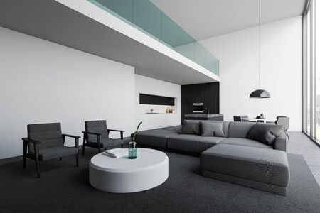 Corner of open plan room with living room area with gray sofa and armchairs near round coffee table and kitchen with white and dark wooden walls, island, countertops and table. 3d rendering