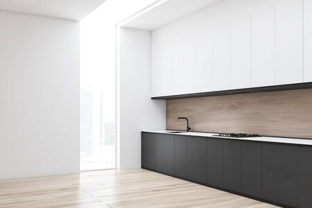 Corner of minimalistic kitchen with white and wooden walls, wooden floor, gray countertops with built in sink and cooker and white cupboards. 3d rendering Stock fotó