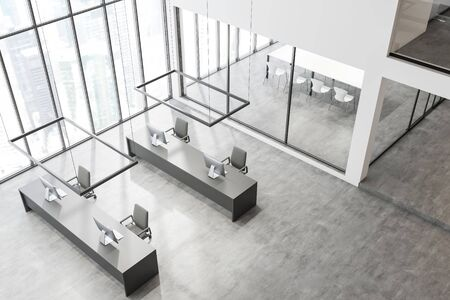 Top view of modern open space office with white walls, panoramic windows, row of long gray computer tables and conference room with glass walls in background. 3d rendering
