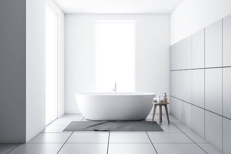 Interior of minimalistic bathroom with white and tiled walls, two narrow windows and comfortable white bathtub with carpet and chair with towels and shampoos. 3d rendering