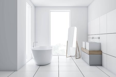 Interior of stylish bathroom with white and tiled walls, comfortable bathtub, double sink standing on gray and wooden countertop and mirror on the floor. 3d rendering