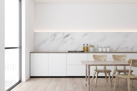 Interior of modern kitchen with white and marble walls, wooden floor, white countertops with built in cooker and wooden dining table with chairs. 3d rendering Stock fotó