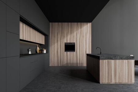 Interior of stylish kitchen with grey and wooden walls, concrete floor, gray countertops, wooden island with built in sink and oven. 3d rendering 写真素材