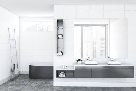 Interior of luxury bathroom with white tile walls, comfortable gray bathtub, double sink standing on gray countertop with three large mirrors above it and metal ladder with towel. 3d rendering Фото со стока