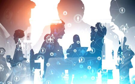 Silhouettes of managers in modern office with double exposure of business people and HUD social network interface. Toned image Stockfoto