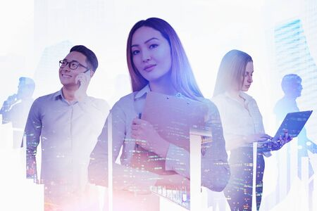 Confident Asian woman with clipboard, smiling Asian man on phone, serious businesswoman with laptop in city. Concept of teamwork. Toned image double exposure Stockfoto