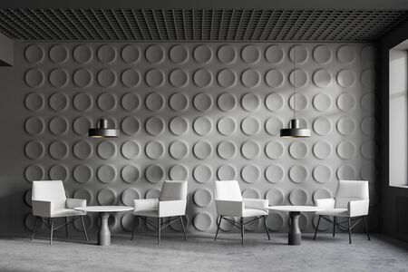 Interior of modern office waiting room with gray geometric pattern walls, concrete floor and comfortable white armchairs standing near round coffee tables. 3d rendering Stockfoto