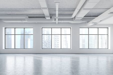 Spacious empty office in industrial style with white walls, concrete floor and large windows with cityscape. 3d rendering Stockfoto