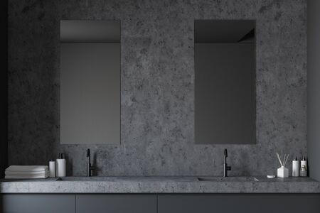 Interior of stylish bathroom with gray and stone walls, double sink standing on grey countertop and two vertical mirrors. 3d rendering Stock fotó - 129410040