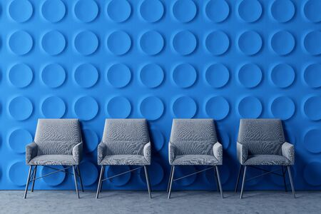 Row of comfortable gray armchairs in modern office lounge area with dark blue geometric pattern walls and concrete floor. 3d rendering Фото со стока