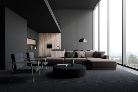 Interior of open plan room with living room area with beige sofa and armchairs near round coffee table and kitchen with gray and dark wooden walls, island, countertops and table. 3d rendering Stockfoto