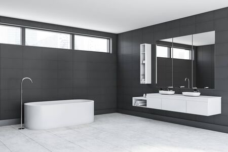 Corner of luxury bathroom with grey tile walls, concrete floor, comfortable white bathtub and double sink standing on white countertop with big mirror above it. 3d rendering