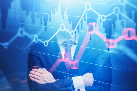 Confident young trader standing with crossed arms with double exposure of graphs. Concept of stock market. Toned image