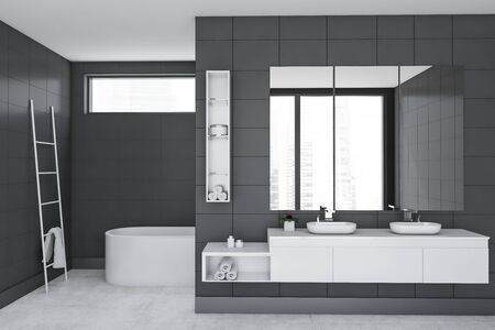 Interior of luxury bathroom with grey tile walls, comfortable white bathtub, double sink standing on white countertop with three large mirrors above it and metal ladder with towel. 3d rendering