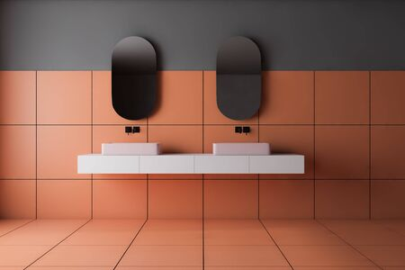 Interior of stylish bathroom with gray and orange tile walls and angular pink double sink on white countertop with two mirrors above it. 3d rendering