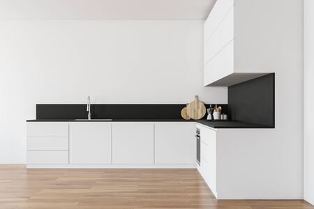 Interior of minimalistic kitchen with white walls, wooden floor, white countertops with built in sink and cooker and comfortable white cupboards. 3d rendering Stock fotó - 129410172