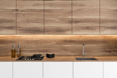Close up of stylish white kitchen countertop with built in sink and cooker standing in modern kitchen with wooden walls and cupboards. 3d rendering Stock fotó