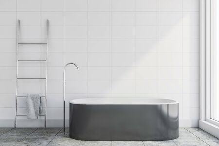 Interior of stylish bathroom with white tile walls, gray tiled floor, comfortable gray bathtub and metal ladder with towel on it. 3d rendering Stockfoto
