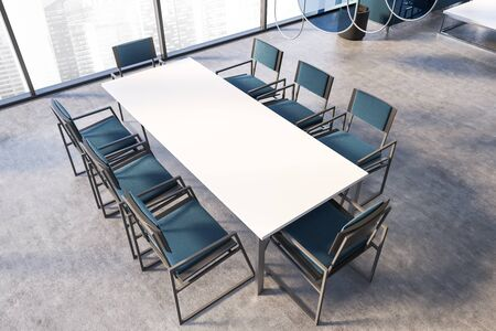 Top view of panoramic office meeting room with cityscape, concrete floor, long white table with blue chairs and blue glass decoration elements. 3d rendering Stockfoto
