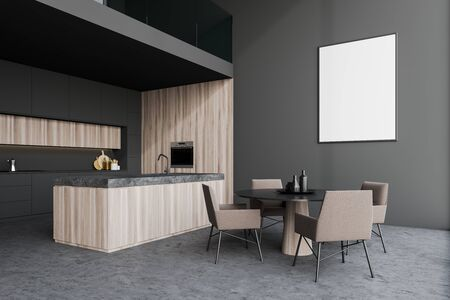 Interior of modern kitchen with gray and wooden walls, gray countertops, island with sink, round dining table with beige chairs and vertical mock up poster frame. 3d rendering