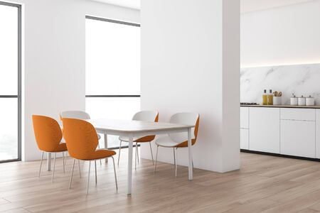 Corner of modern kitchen with white and marble walls, wooden floor, white countertops with built in cooker and wooden dining table with orange chairs. 3d rendering