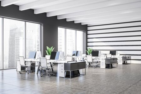 Corner of modern open space office with white and gray walls, tiled floor, windows with cityscape and rows of white computer tables with chairs. 3d rendering