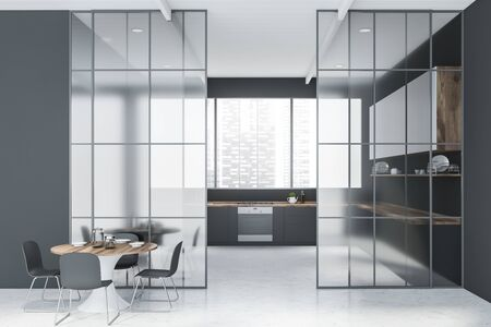 Interior of stylish kitchen with gray walls, panoramic window, gray countertops, white cupboards, round dining table with chairs and glass doors. 3d rendering Stockfoto
