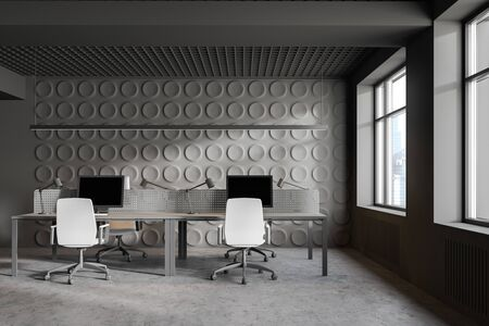 Interior of modern office workplace with gray geometric pattern walls, concrete floor, two of gray computer tables with white chairs and window with cityscape. 3d rendering