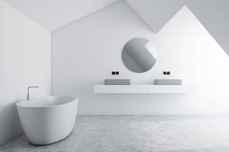Interior of stylish bathroom with white walls, concrete floor, white bathtub and double sink standing on white shelf with round mirror. 3d rendering