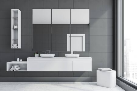 Interior of stylish bathroom with gray tile walls, white tiled floor, double sink standing on white countertop and three vertical mirrors above it. 3d rendering