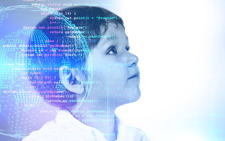 Adorable smart little boy thinking and looking upwards with double exposure of planet hologram and lines of code. Concept of programming and hi tech. Toned image mock up Stok Fotoğraf