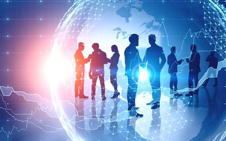 Silhouettes of business people working together and shaking hands over Earth background and digital graphs. Concept of teamwork. Toned image double exposure. Stockfoto