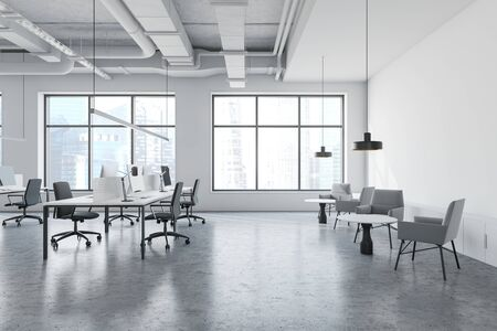 Interior of modern open space office in industrial style with white walls, concrete floor, long computer tables with chairs and lounge area with armchairs and coffee tables. 3d rendering Banco de Imagens
