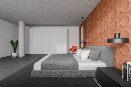 Side view of stylish bedroom with white and orange geometric pattern walls, concrete floor, king size bed, white wardrobe and bright orange armchair. 3d rendering