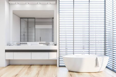 Interior of stylish bathroom with white walls, wooden floor, comfortable white bathtub and double sink on white countertop with large mirror above it. 3d rendering