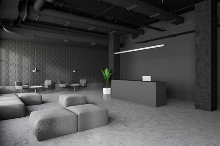 Corner of spacious industrial style office with dark gray walls, concrete floor, reception desk with laptops and waiting room with armchairs, poufs and coffee tables. 3d rendering