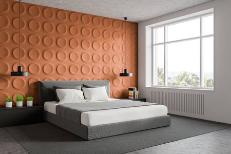Corner of stylish bedroom with orange geometric pattern and white walls, concrete floor with carpet, king size bed and two gray bedside tables. 3d rendering
